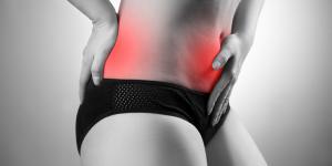 Estómago inflamado y dolor de espalda: causas