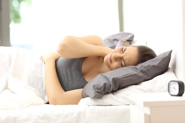 Estómago inflamado y dolor de espalda: causas - Sistema músculoesquelético